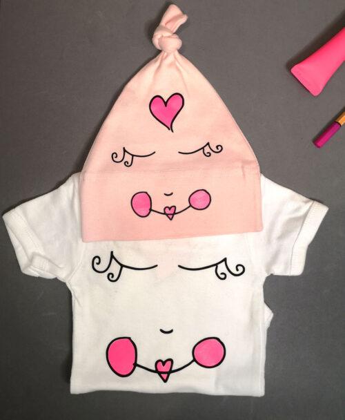 body bebe manga corta blanco con dibujos originales disenos divertidos cara nina rosa neon